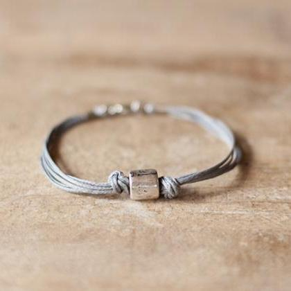 Men's bracelet with a silver tube c..